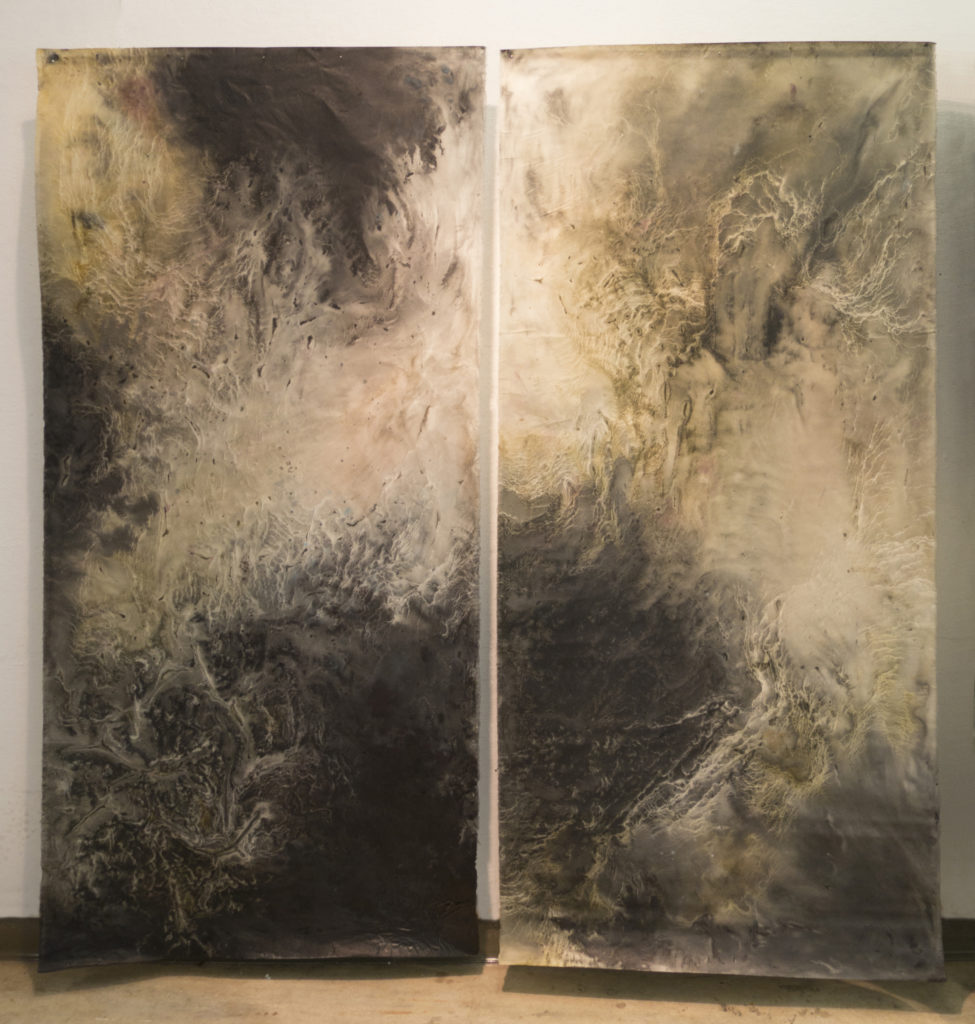 Two large format monotypes hung offset from the wall